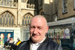 Mark standing next to Bath Abbey.