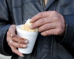 Client holding cup of soup