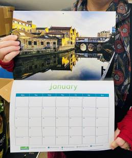 Genesis Trust 2021 calendar open at the month January, showing image of Bath waterways