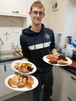 Volunteer holding Christmas meals