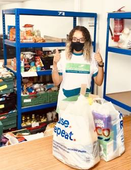 i3 works employee packing at the Bath Foodbank