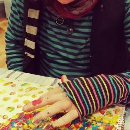 A client painting a colourful picture during an art therapy session.
