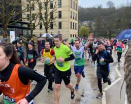 Genesis Trust runner running in the Bath Half.